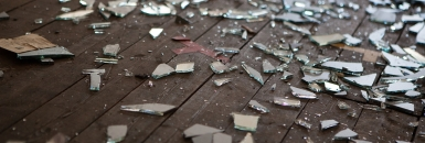 Photo of broken glass on floor